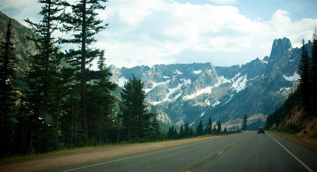 snow capped mountains and road